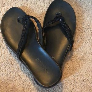 Black embellished flip flops